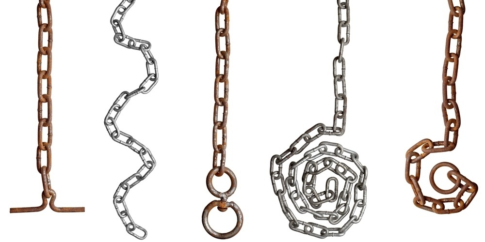 collection of metal chain parts on white background. each one is in full cameras resolution-565759-edited.jpeg